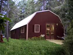 Kit homes guest house and cabin kits for Gambrel roof metal building
