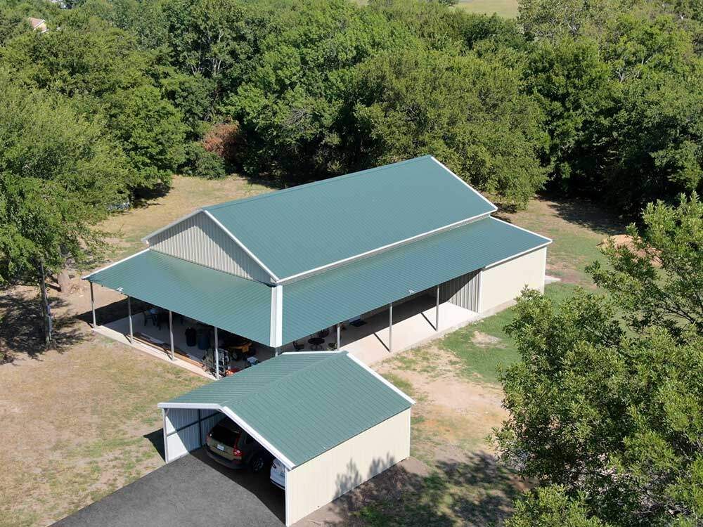 Barndominium with matching carport